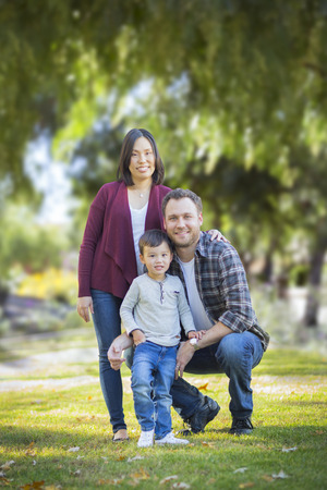 chinese lady: Happy Attractive Mixed Race Young Family Portrait Outdoors. Stock Photo