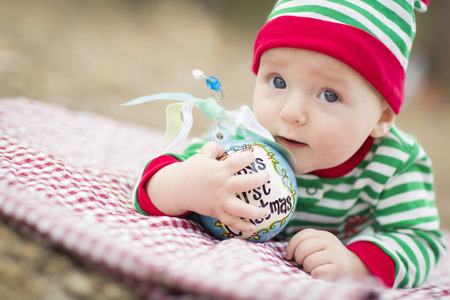 blue eyed: Beautiful Infant Baby On Blanket With Babys First Christmas Ornament.
