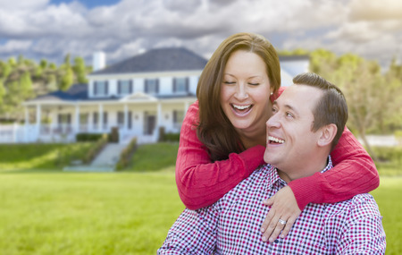 home family: Happy Affectionate Laughing Couple Outdoors In Front of Beautiful House.