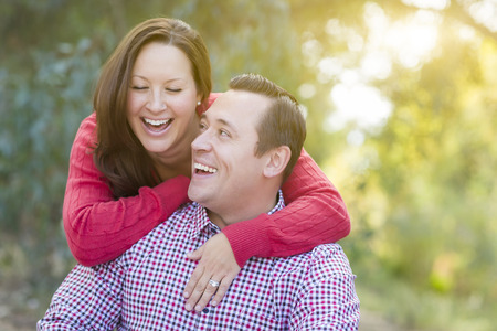 happy smiling: Attractive Happy Caucasian Couple Laughing Outdoors.
