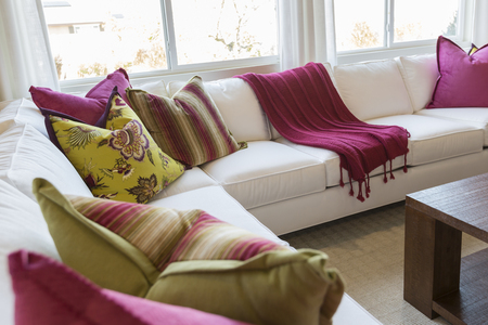 reception: Beautiful Abstract of Inviting Colorful Couch Sitting Area and Table.