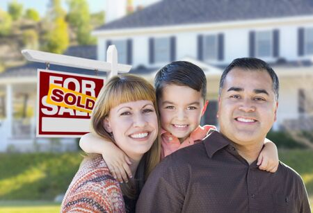 mixed couple: Happy Mixed Race Young Family in Front of Sold Home For Sale Real Estate Sign and House.
