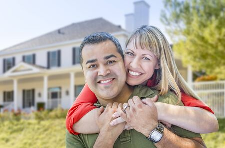 mixed race: Happy Mixed Race Couple in Front of Beautiful House.