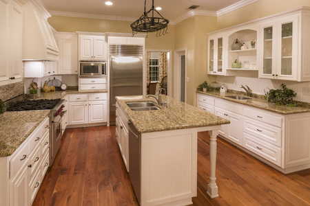 white wood floor: Beautiful Custom Kitchen Interior in a New House. Stock Photo