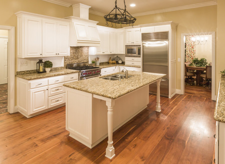 country house style: Beautiful Custom Kitchen Interior in a New House. Stock Photo