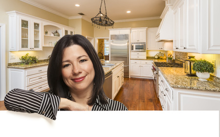 buyer: Hispanic Woman Leaning Against White Board In Custom Kitchen Interior.