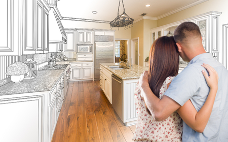 a kitchen: Young Military Couple Looking Inside Custom Kitchen and Design Drawing Combination.