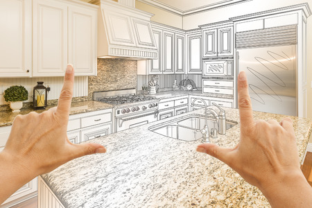 dream: Female Hands Framing Gradated Custom Kitchen Design Drawing and Photo Combination. Stock Photo