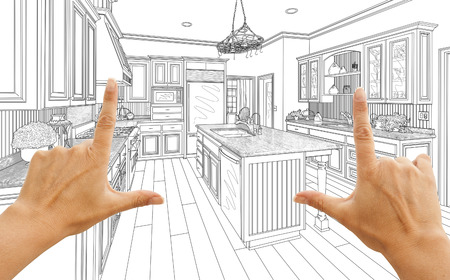 female hands: Female Hands Framing Custom Kitchen Design Drawing.