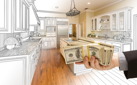 hundreds: Hand Handing Stacks of Money Over Custom Kitchen Design Drawing and Photo Combination.