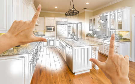 hoping: Female Hands Framing Custom Kitchen Design Drawing and Photo Combination. Stock Photo