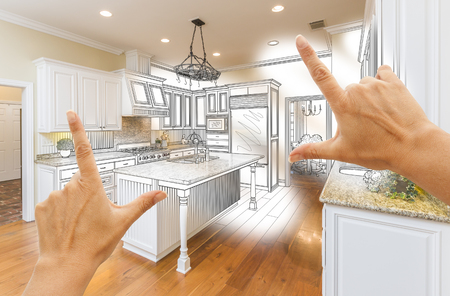 framing: Female Hands Framing Custom Kitchen Design Drawing and Photo Combination. Stock Photo