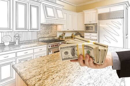 handing: Hand Handing Stacks of Money Over Custom Kitchen Design Drawing and Photo Combination.