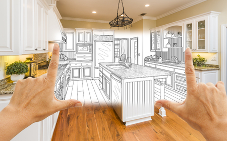 framing: Female Hands Framing Custom Kitchen Design Drawing and Square Photo Combination.
