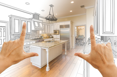 Female Hands Framing Gradated Custom Kitchen Design Drawing and Photo Combination. Stock Photo