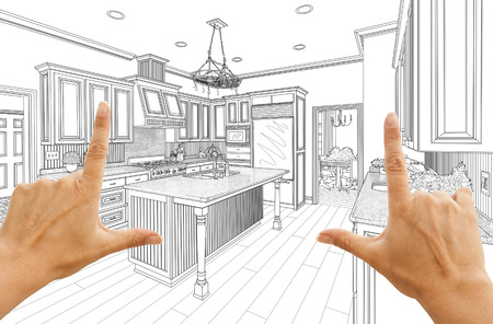 framing: Female Hands Framing Custom Kitchen Design Drawing.