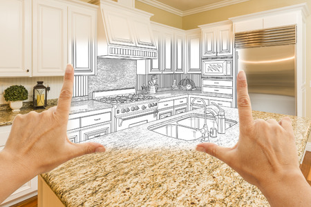 female hands: Female Hands Framing Custom Kitchen Design Drawing and Square Photo Combination.
