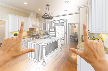 construction project: Female Hands Framing Gradated Custom Kitchen Design Drawing and Photo Combination. Stock Photo