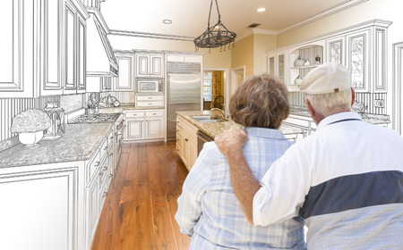 seniors: Senior Couple Looking Over Custom Kitchen Design Drawing and Photo Combination.