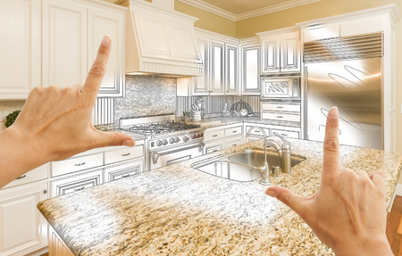 construction project: Female Hands Framing Custom Kitchen Design Drawing and Photo Combination. Stock Photo