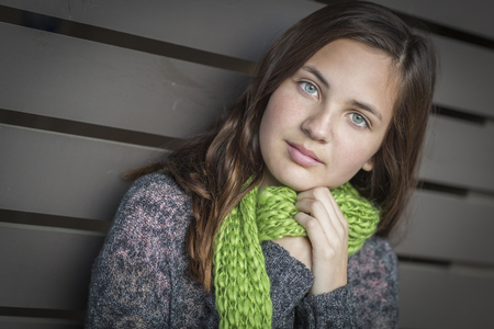 teenaged girls: Portrait of Young Pretty Blue Eyed Girl Wood Background.