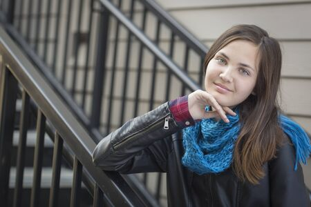 teenaged girls: Portrait of Pretty Young Girl Weather Leather Jacket on Staircase.