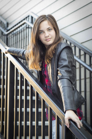 Portrait of Pretty Young Girl Weather Leather Jacket on Staircase.