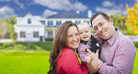 happy families: Happy Young Family With Baby Outdoors In Front of Beautiful Custom Home. Stock Photo