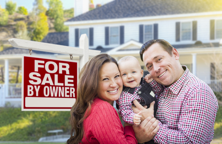 sign in: Happy Young Family In Front of For Sale By Owner Real Estate Sign and House.