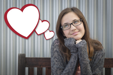 teenaged girls: Cute Daydreaming Girl With Blank Floating Hearts Clipping Path Included.