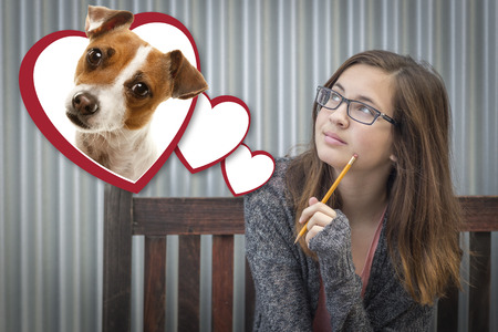 love hearts: Cute Daydreaming Girl Next To Floating Hearts with Puppy Within. Stock Photo