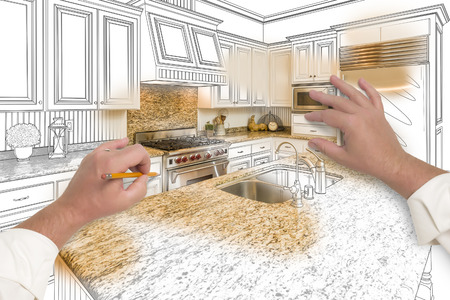 Male Hands Sketching with Pencil A Custom Kitchen with Photo Showing Through. Stockfoto