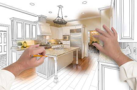 architect drawing: Male Hands Sketching with Pencil A Custom Kitchen with Photo Showing Through. Stock Photo