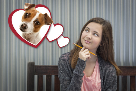 teenaged girls: Cute Daydreaming Girl Next To Floating Hearts with Puppy Within. Stock Photo