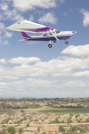 cessna: The Cessna 172 Single Propeller Airplane Flying In The Sky.