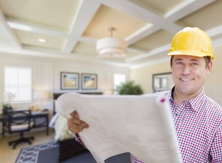 hard hat: Smiling Contractor in Hard Hat with Roll of Plans Over Custom Bedroom Drawing and Photo Combination.