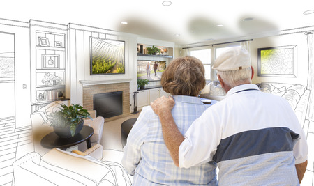living room design: Curious Senior Couple Looking Over Custom Living Room Design Drawing Photo Combination.