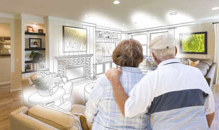 senior couple: Curious Senior Couple Looking Over Custom Living Room Design Drawing Photo Combination.