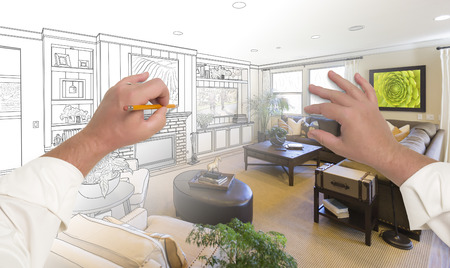 drawing room: Male Hands Drawing Custom Living Room Design Gradating Into Photograph. Stock Photo