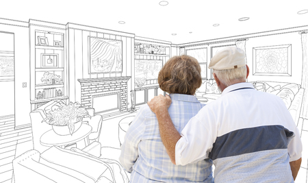 living room design: Curious Senior Couple Looking Over Custom Living Room Design Drawing.