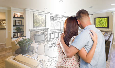 design drawing: Curious Young Military Couple Looking Over Custom Living Room Design Drawing Photo Combination. Stock Photo