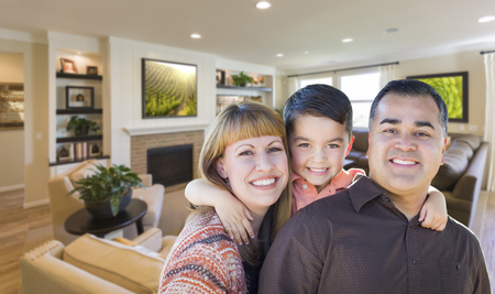 inside house: Happy Young Mixed Race Family Portrait In Living Room of Home.