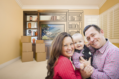 family units: Young Family In Room With Moving Boxes and Drawing of Entertainment Unit On Wall. Stock Photo