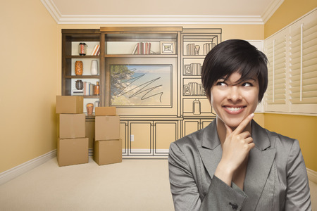 envisioning: Young Mixed Race Female Looking To The Side In Room With Drawing of Entertainment Unit On Wall.