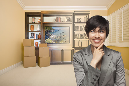 Young Mixed Race Female Looking To The Side In Room With Drawing of Entertainment Unit On Wall. photo