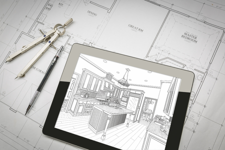 condominium: Computer Tablet Showing Kitchen Illustration Sitting On House Plans With Pencil and Compass.