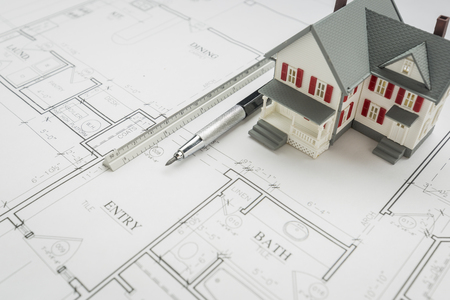 architect tools: Model Home, Engineer Pencil and Ruler Resting On Custom House Plans. Stock Photo