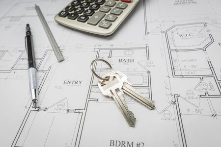 do it yourself: Pencil, Ruler, Calculator and Keys Resting on Custom House Plans. Stock Photo