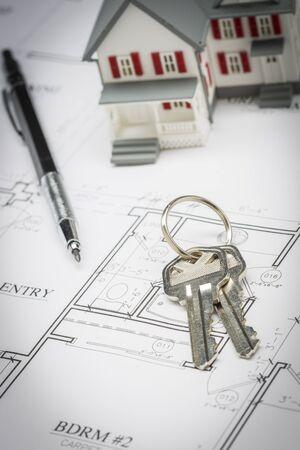 model home: Model Home, Pencil and Keys Resting On Custom House Plans.