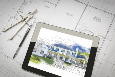 Computer Tablet Showing House Illustration Sitting On House Plans With Pencil and Compass.